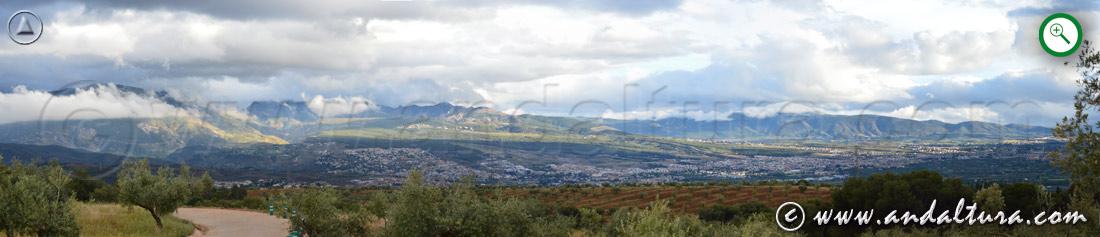 Teclea en la imagen y amplia la vista de las nubes sobre la Vega de Granada